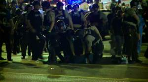 More than a dozen arrests in 4th night of Ferguson protests